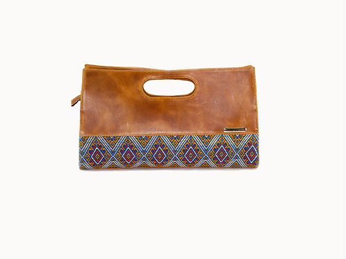Guatemalan handbag with mayan symbols and light blue embroidery and full grain leather, front view