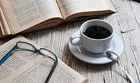 books-coffee-table-reading-glasses.jpg