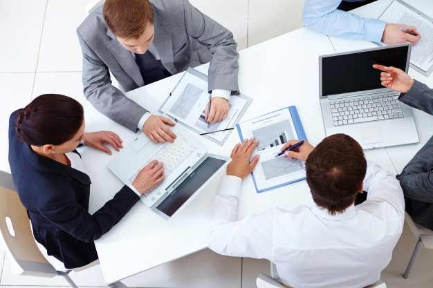top-view-co-workers-planning-strategy_10