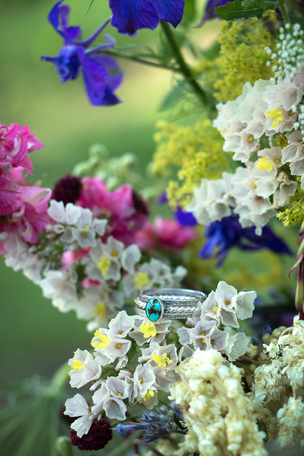 Wedding rings and wild florals