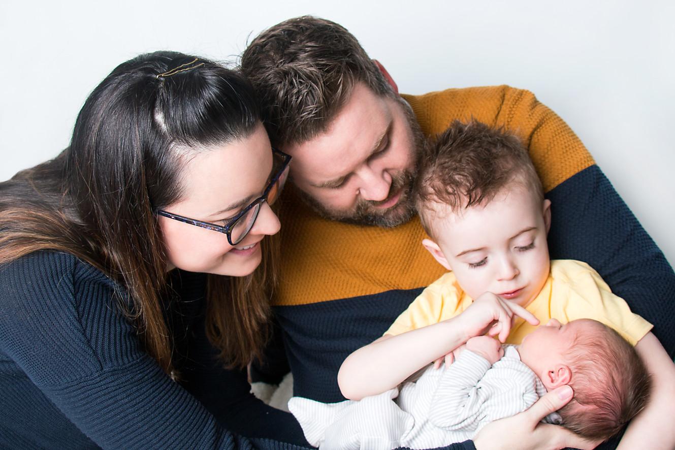 Family cradles newborn