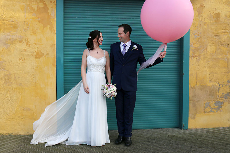 colourful wedding portrait with giant balloon