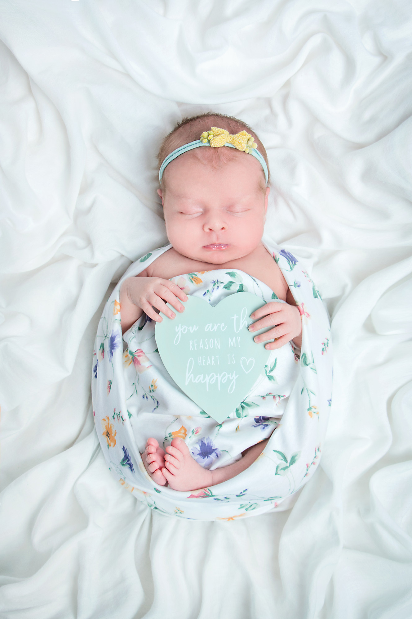 Sleeping wrapped newborn baby girl