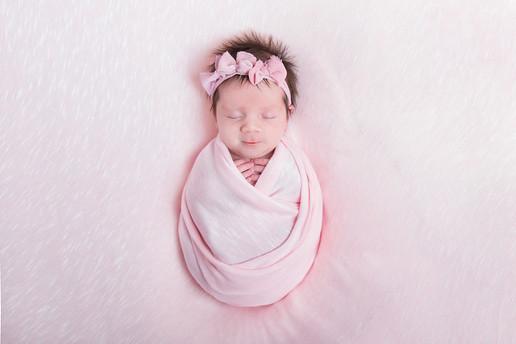 Sleeping Newborn girl in pink wrap set