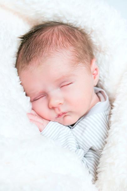 Sleepy cosey newborn Issac
