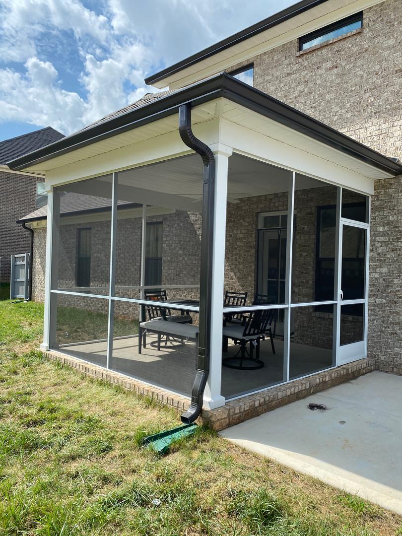 White frame aluminum screen porch