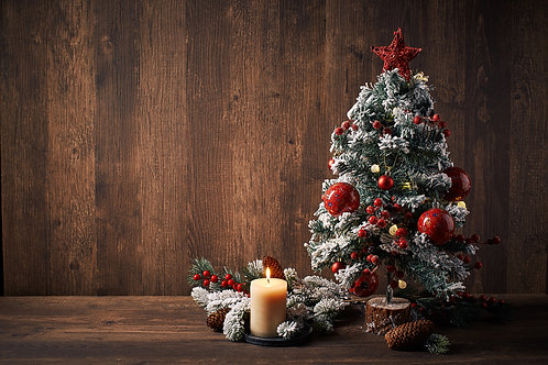 Classic Christmas Tree and candle light on wooden background