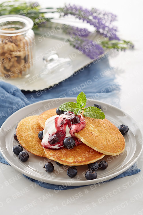 Pancakes with blueberries and greek style natural yogurt  - Portrait