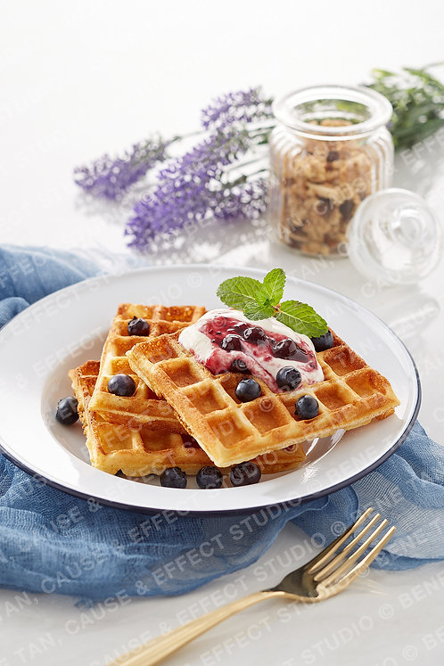 Classic Waffles with blueberries and greek style natural yogurt  - Portrait