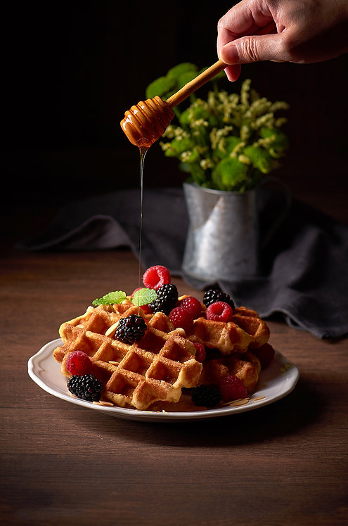 Belgian Waffles with raspberries, strawberries and honey dip action