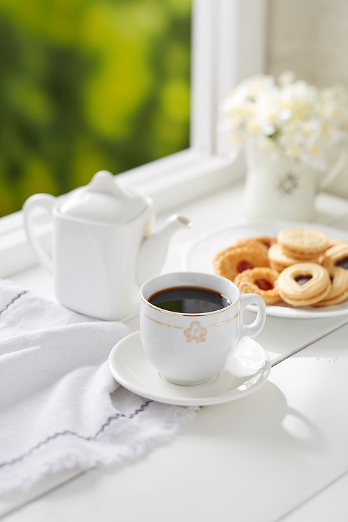 Local Kopi O with assorted biscuits on white rustic wooden top