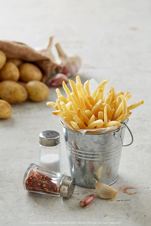 Potato French fries served in rustic metal container