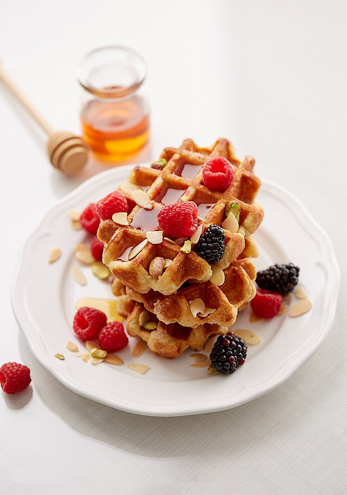 Belgian Waffles with blackberries, raspberries and almonds. High angle