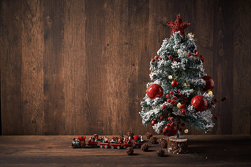Classic Christmas Tree with wooden toy train on wooden background