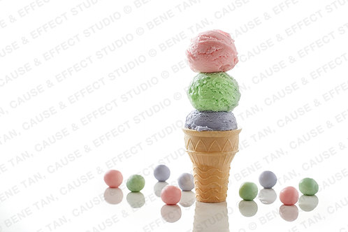 3 flavours ice cream stacked on a wafer cup cone