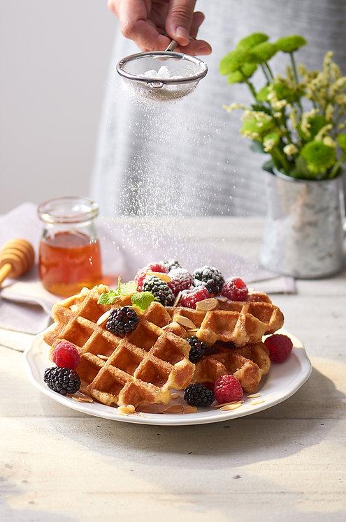 Belgian Waffles with blackberries, raspberries, almonds and icing sugar action