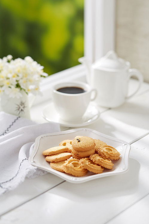 Danish Butter Cookies with coffee on white rustic wooden top