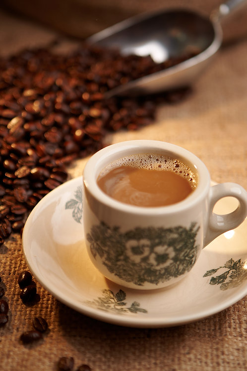 White Coffee with roasted coffee beans at the background
