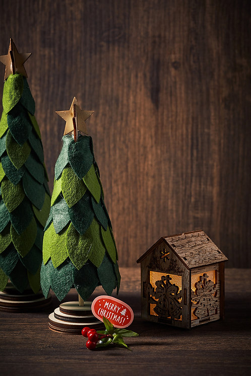 Paper Art Christmas Tree and wooden house on wooden background