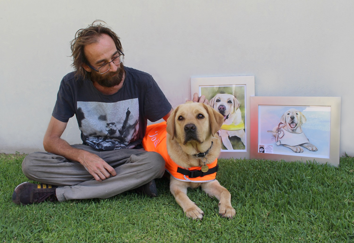 Simon with Jock and the portraits