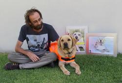 Simon with Jock and the portraits