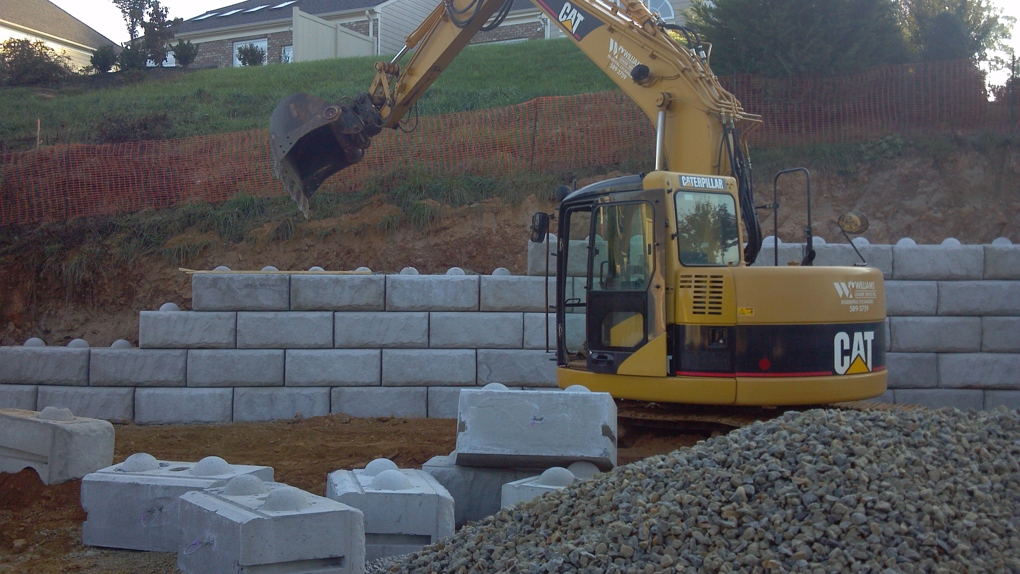 Building large block retaining wall