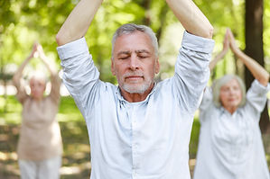 Tai Chi Group Hands above head.jpg