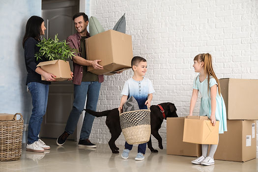 Family with dog moving in with boxes .jp