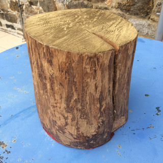 And old tree trunk repurposed as a seat or small table.