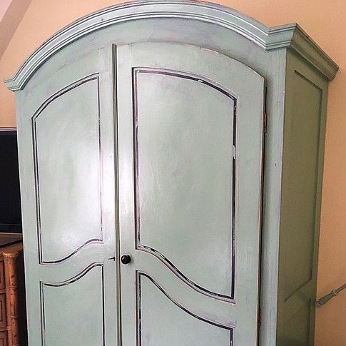 Vintage wardrobe upcycled with a distressed look.