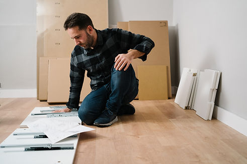 portrait-of-man-assembling-furniture-do-