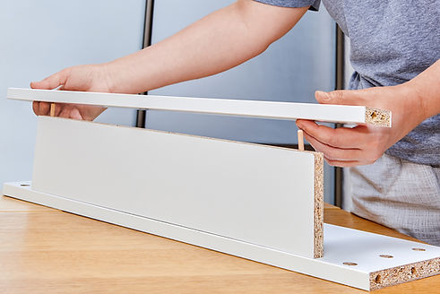 assembly-of-furniture-installer-putting-