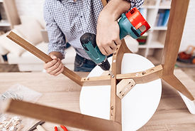 furniture-assembler-with-drill-in-hands-