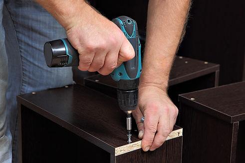 assembling-furniture-hands-of-carpenter-
