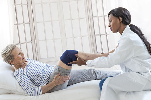 Physiotherapy - therapist doing leg stre