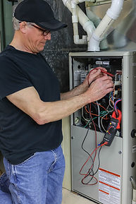 Furnace Repairman Servicing High Efficie