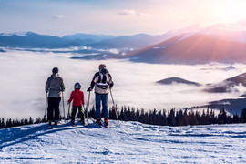 3 skier family overlooking clouds.jpg
