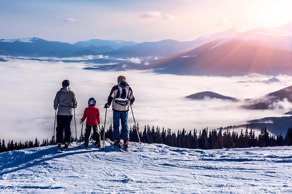 3 skier family overlooking clouds.jpg