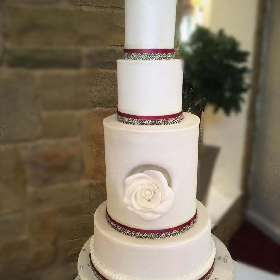 Slim white tall wedding cake