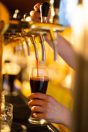 dark-beer-is-poured-into-a-glass-of-beer