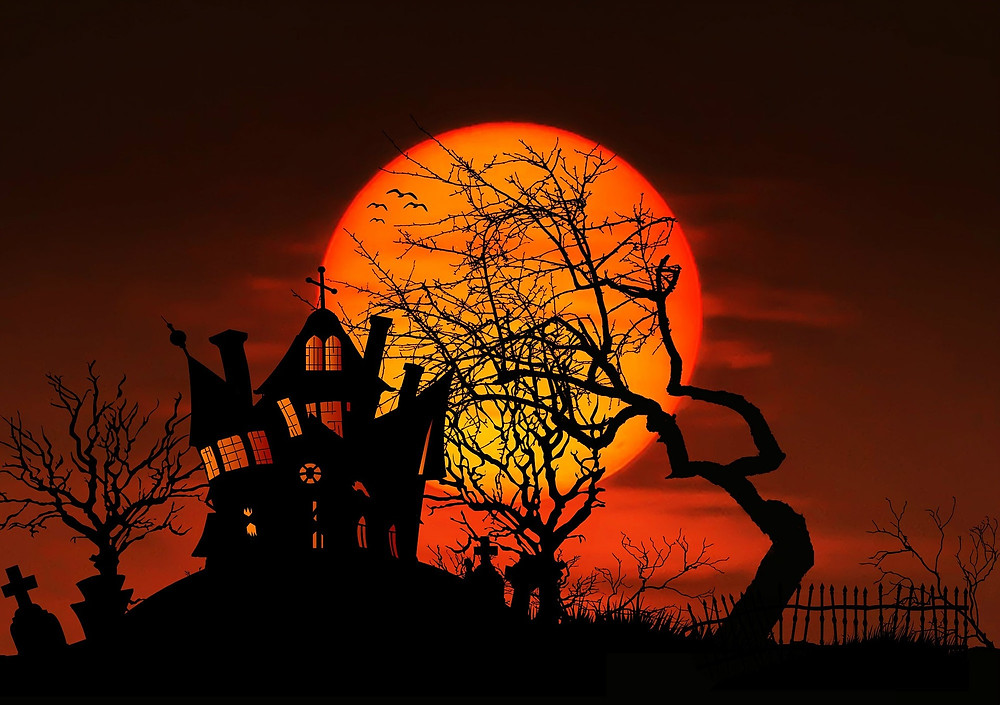 Halloween haunted house with full moon