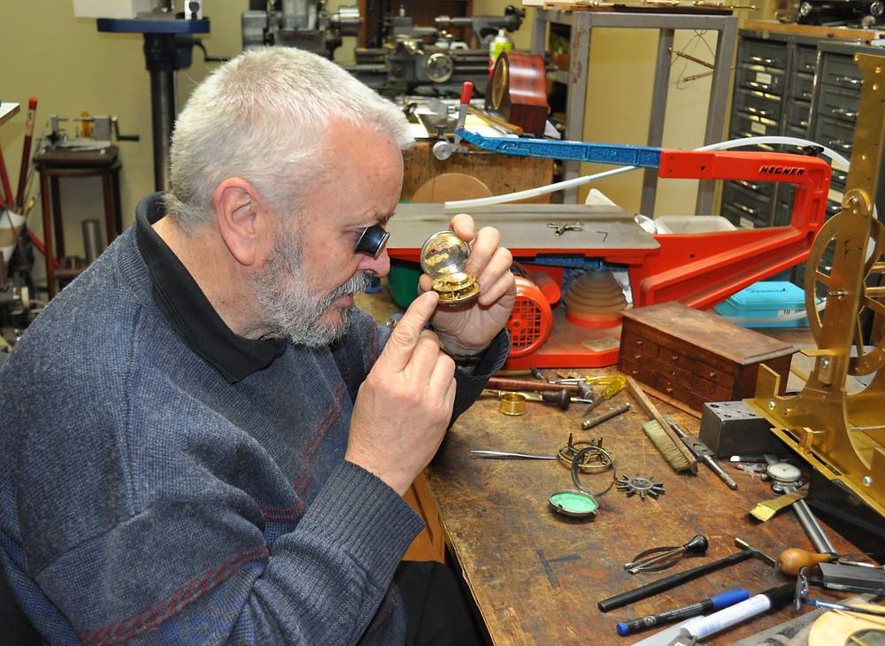 Launceston watchmaker Graham Mulligan works on a 1834 pocket watch in his workshop in York Street.