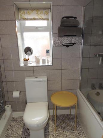 Fully tiled stylish bathroom