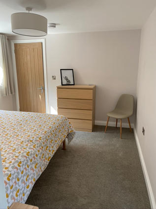 Bedroom with walk in wardrobe and drawers