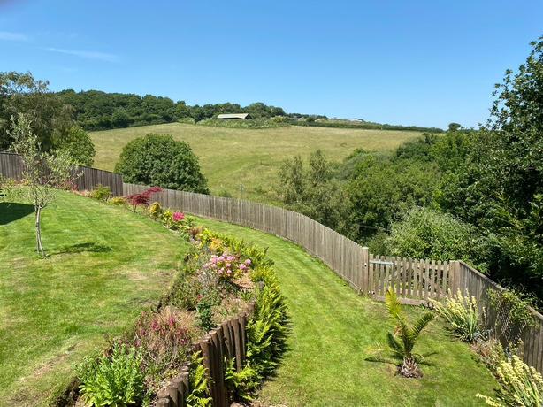 View over our garden to surrounding farmland