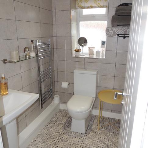 Luxurious fully tiled bathroom