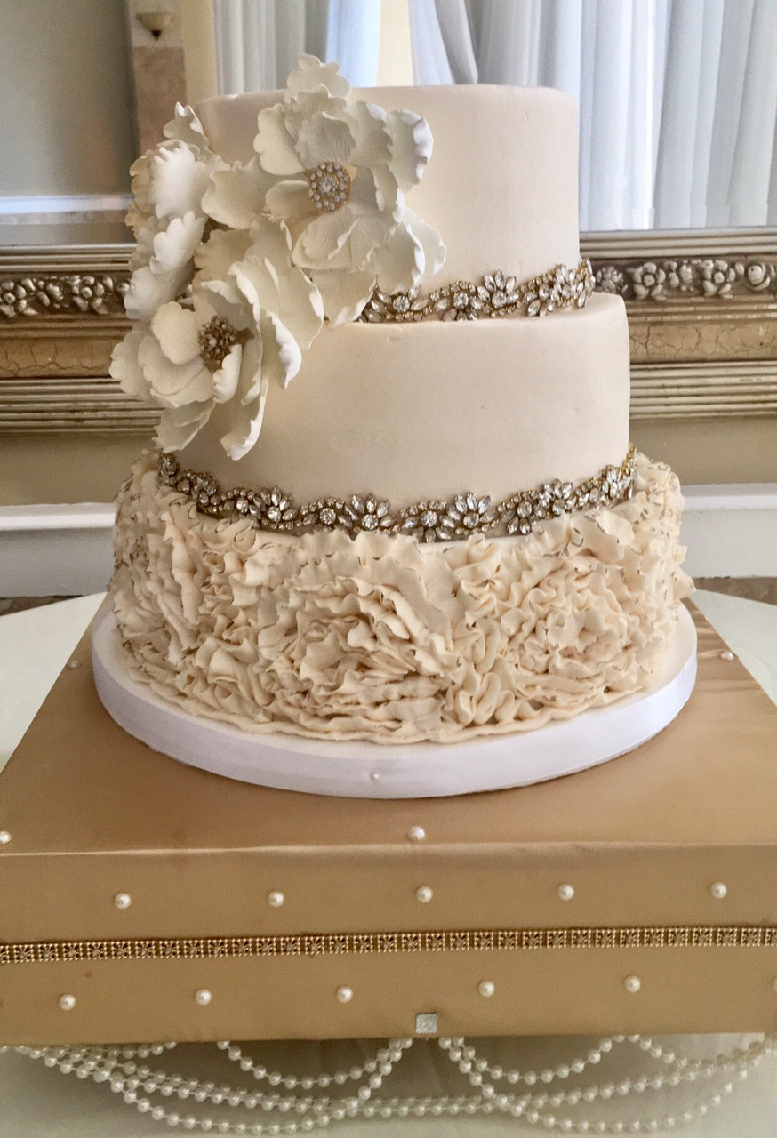 Smooth Buttercream Icing Wedding Cake With A Buttercream Rose Ruffle.  Elegant Rhinestone Border On To Two Tiers. Finishing Touch Of Hand Crafted  Gumpaste ...