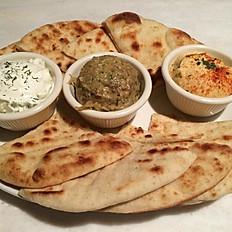Greek Pita accompanied by a trilogy of Greek sauces
