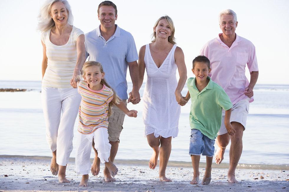 Extended family walking on beach.jpg