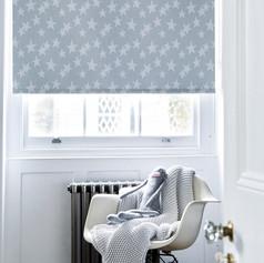 Light gray star patterned roller blinds